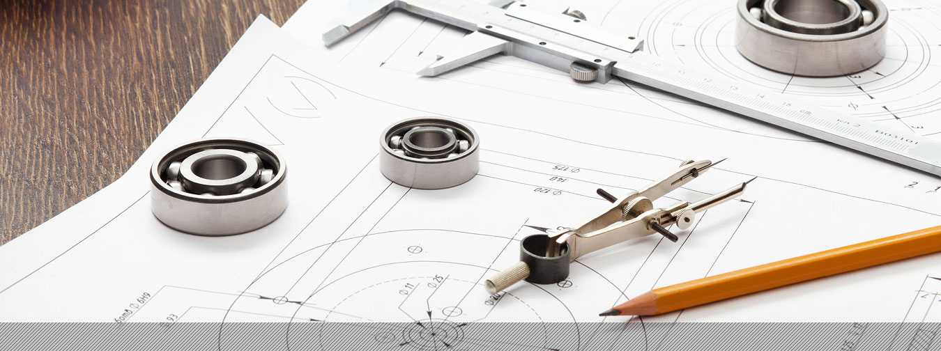 pencil, compass, vernier and CAD drawings on a desk
