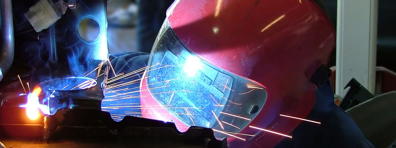 man with red mask metal welding and cutting